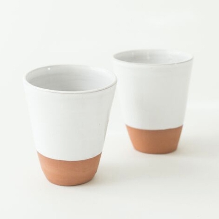 TERRACOTTA DIPPED GLASS | $14 - These Moroccan ceramic glasses are hand thrown and hand painted by talented artisans out of Marrakesh. 10% of sales are  donated to Project Soar, an after-school program empowering young girls in Morocco to continue their education by providing academic support, life skills mentorship and leadership coaching.