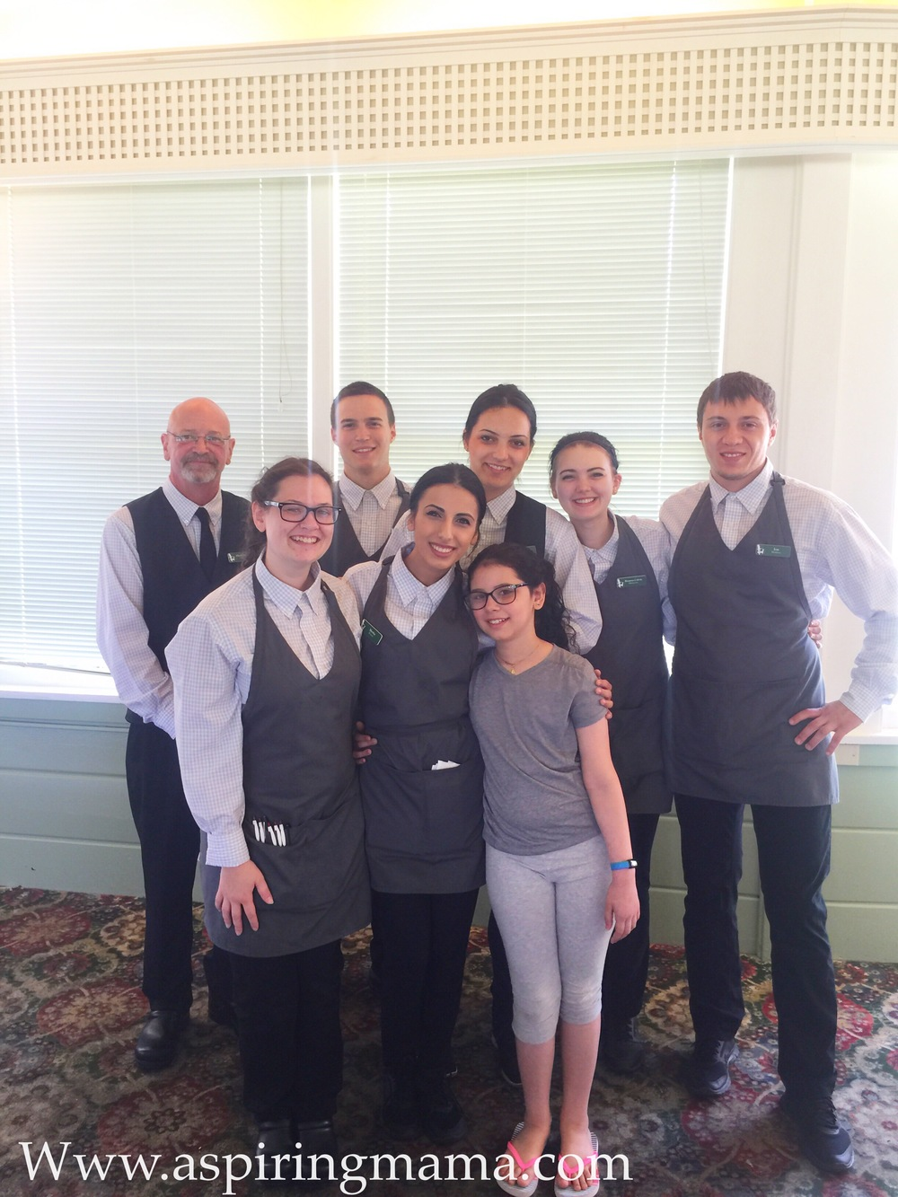 Eliana with the incredible wait staff in the main dining room at Basin Harbor Club.