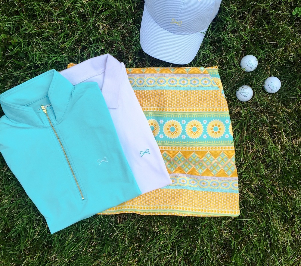 Skylar Popover in turquoise, Lexi Polo in white, Morgan Skort, SE Logo Hat in blue/white
