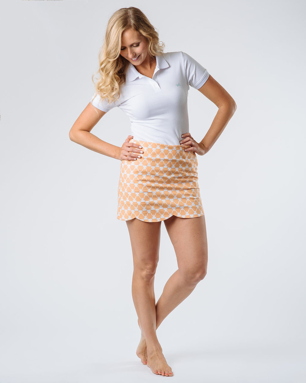 The Lennox Skort paired with The Lexi Short Sleeve Polo in White