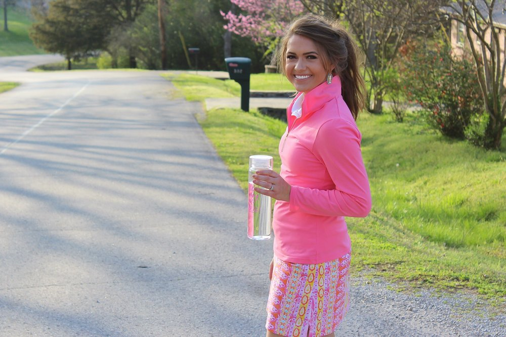 Skylar Popover in Coral Pink, Lexi Sleeveless Polo, Arabella Skort, and ABD Work it Water Bottle