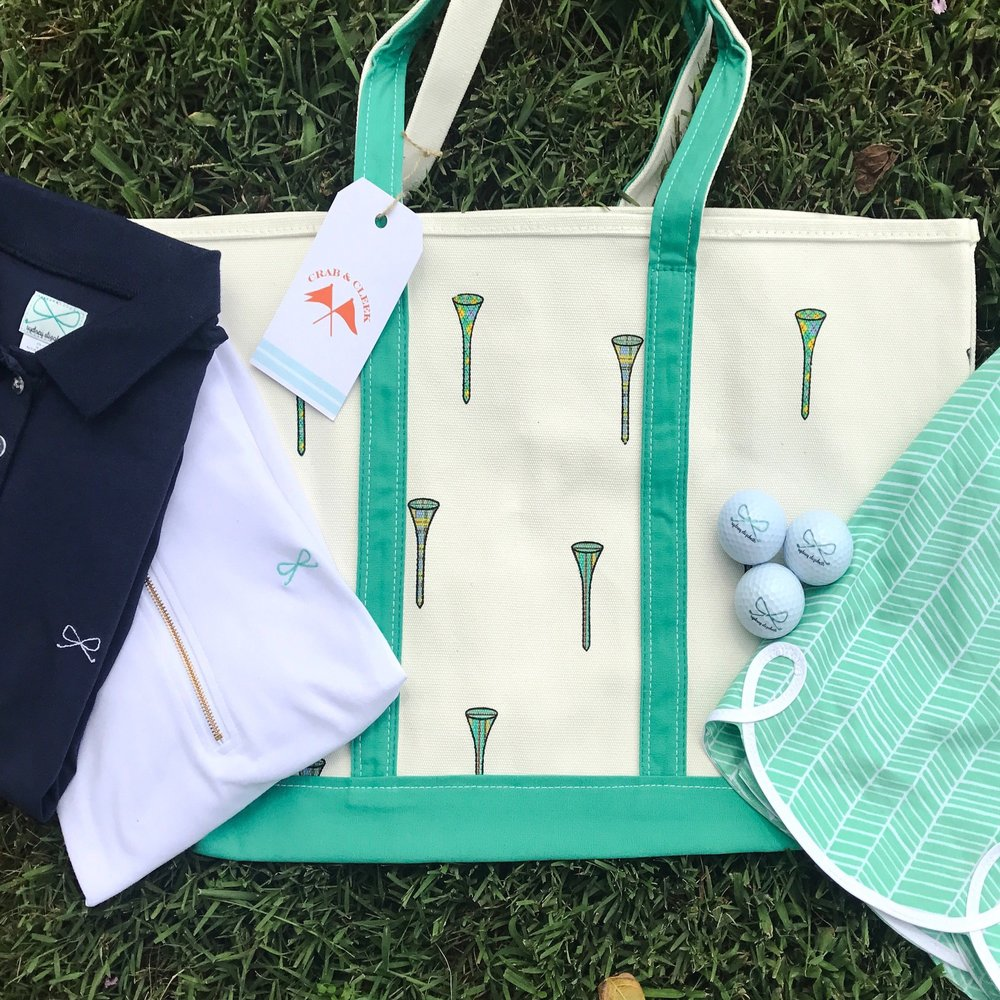 Tee It Up Tote  paired with the  Tinsley Skort ,  Skylar White Pullover , and  Lexi Polo in Navy .