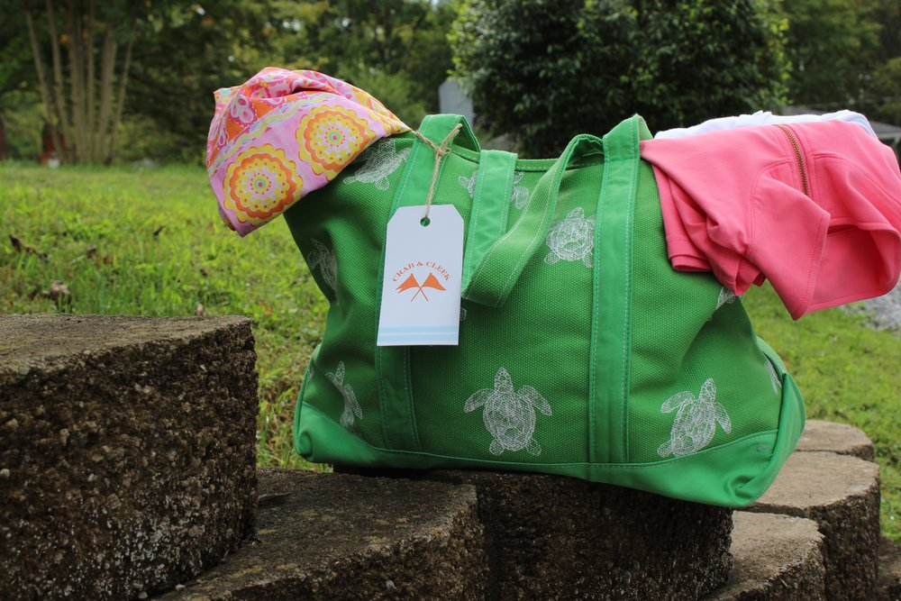Colorwash Green Turtle Tote . Paired with  The Arabella Skort,  and  Skylar Pullover in Coral .