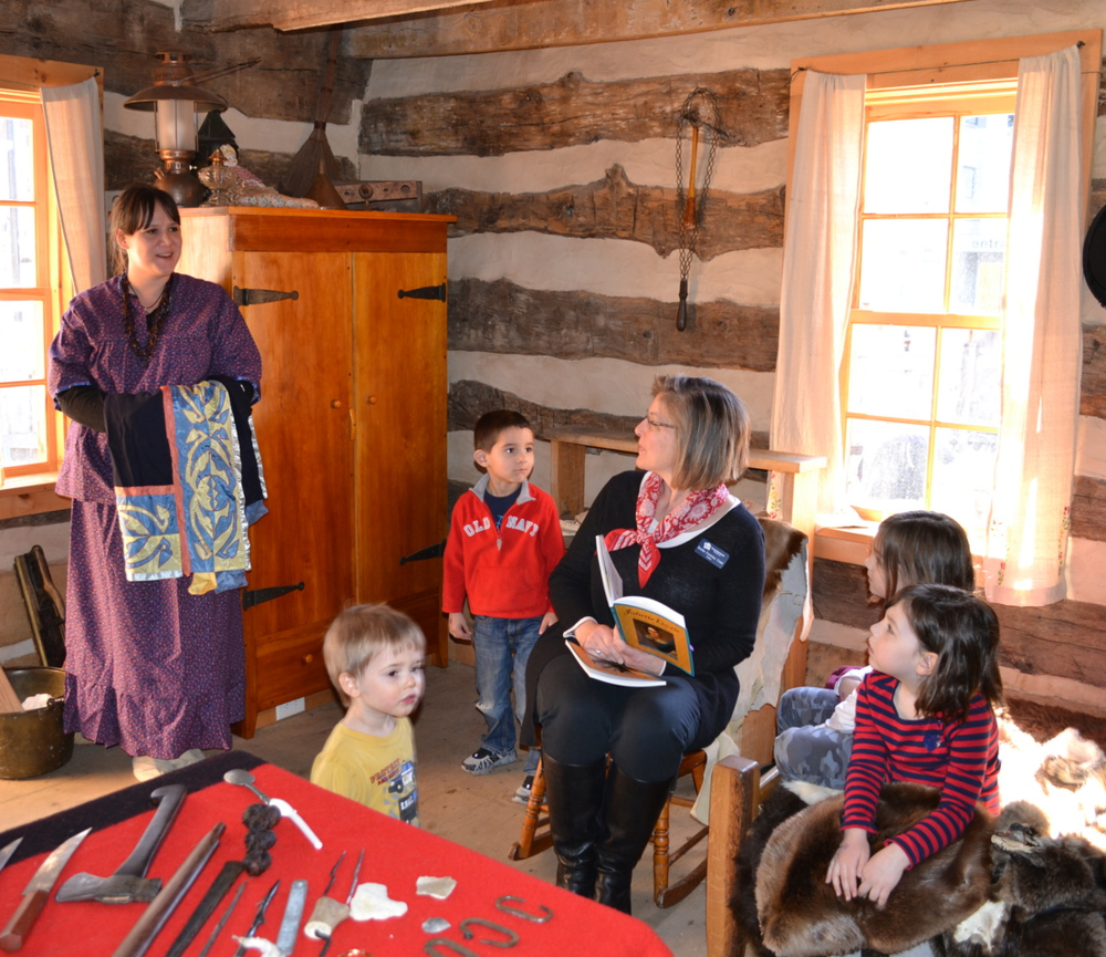 Book Launch event at Madison Children's Museum Log Cabin.  Ho Chunk neighbor Laura RedEagle, Author Kathe Crowley Conn, and Museum visitors read from the book, share stories and talk about life in early Wisconsin.