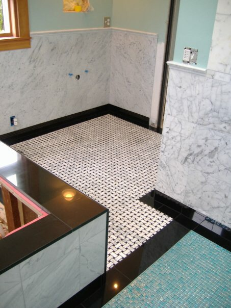 Merveilleux Topping It With A Marble Chair Rail And Absolute Black Granite Baseboard  And Floor Edge, Along With The Black Granite Tub Surround.