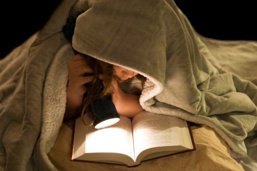 reading by flashlight.jpg