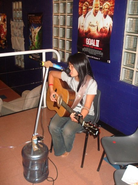 Me at 18 with braces, singing for an open mic. Not quite the story below, but you get the jist. P.s. Check out the makeshift mic stand!