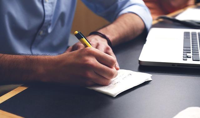A man writing a great financial plan = Hot.
