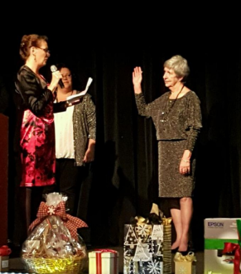 Hazel being Sworn in by the Sequim Association of realtors executive officer, gina valaske.