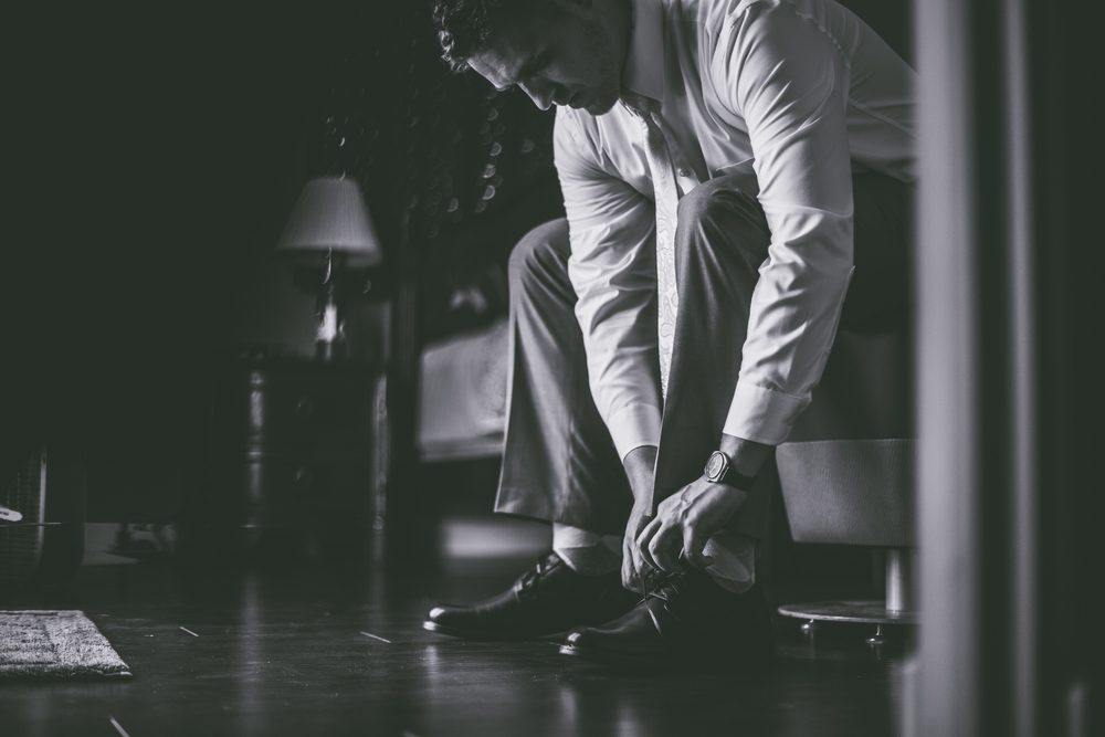 I love this black and white photo of the groom getting ready.