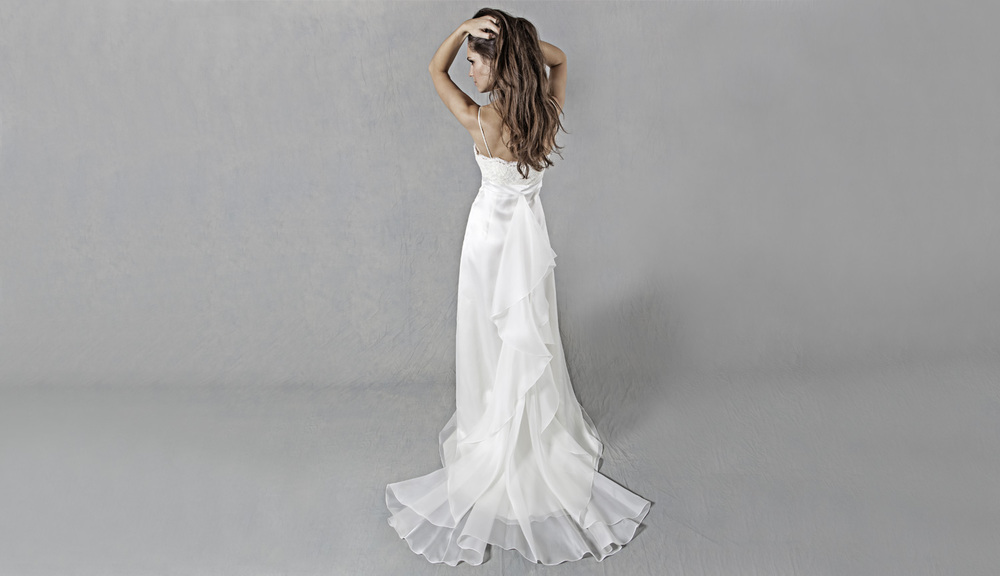 Lucy martin bridal bustle wedding dress for Wedding dress train bustle