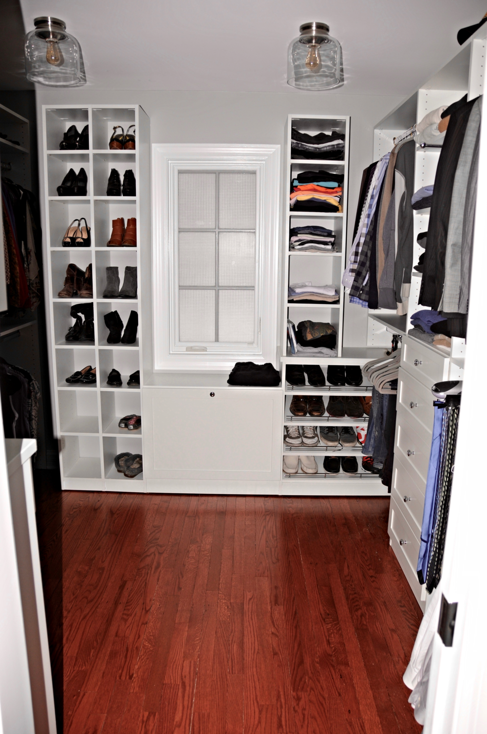 Closet built-ins make good use of the space for organizing and storage. The retractable clothes hamper under the window is a nice feature.