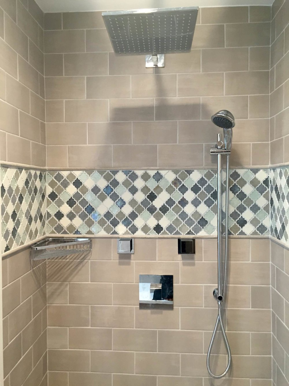 The client picked a mosaic tile accent to add visual interest to the the subway tile.