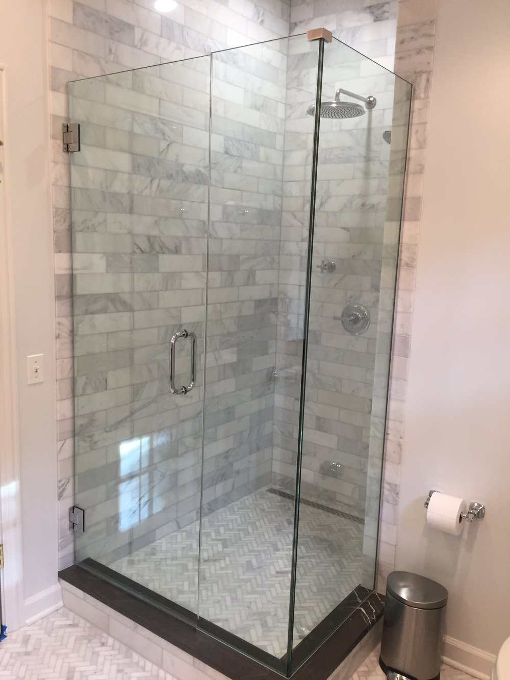 At what height should the shower head be placed? Tall owners require taller than average placement, so it's a good idea to stand in the shower before setting the final plumbing position.