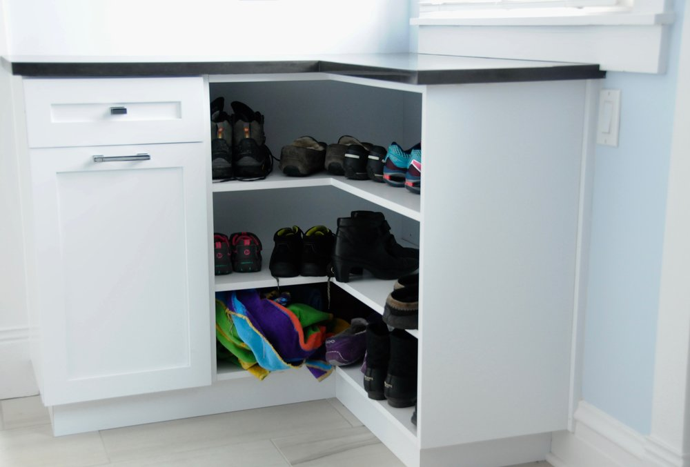 Three levels of extra storage for footwear allow for quick rotation when the weather turns. The top drawer contains leashes, collars, and dog toys for Molly while the bottom drawer holds her food. The quartz countertop and placement near the rear door was designed as a landing zone to handle car keys, cell phones, and groceries.