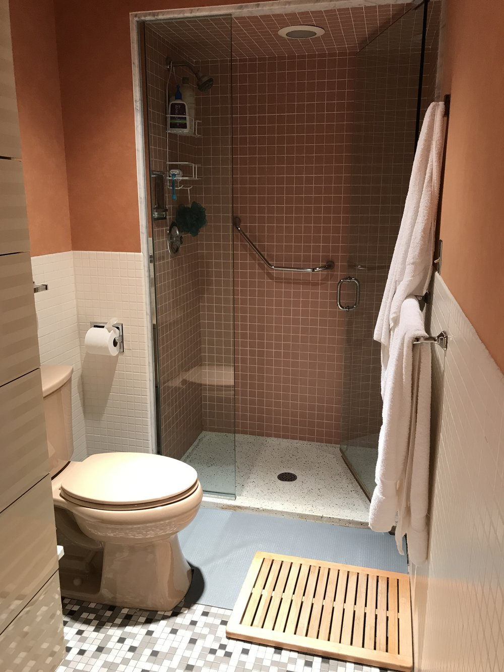 More peach goodness right here, along with different kinds of flooring (but no carpet?!),the small shower, and the mauve toilet.