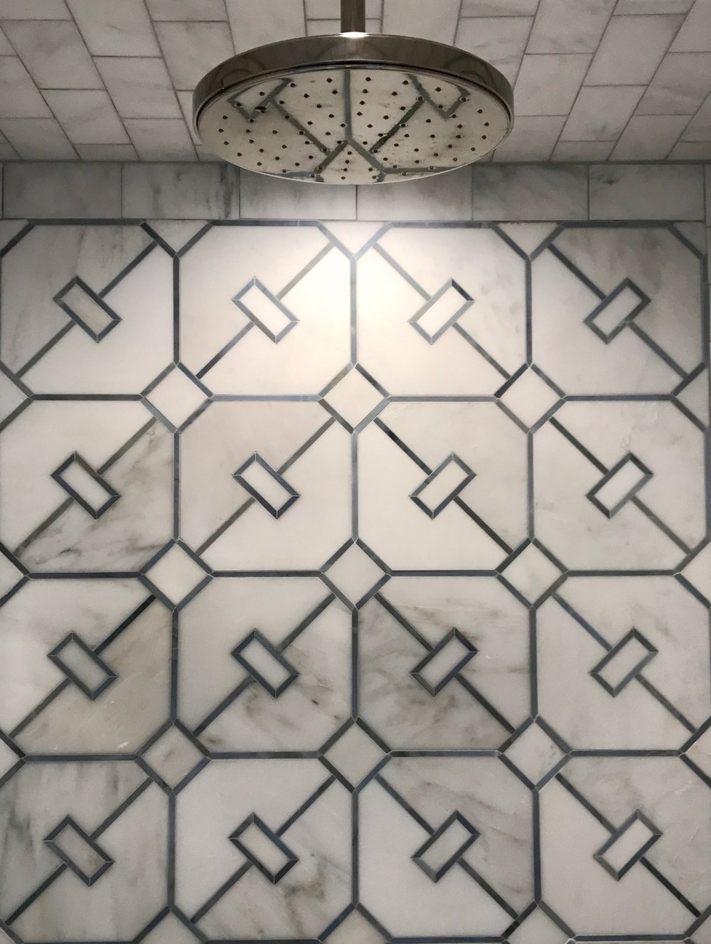 Asian Carrara tile with Cadet Blue geometric pattern. Nickel Silver Raindome by Laura Kirar for Kallista.