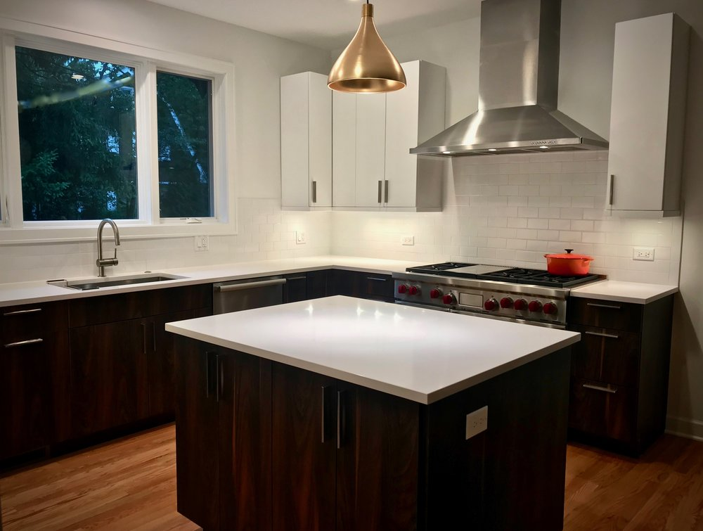 A view of the finished kitchen with cypress-colored lower cabinetry paired with the gloss sheen white upper cabinets.