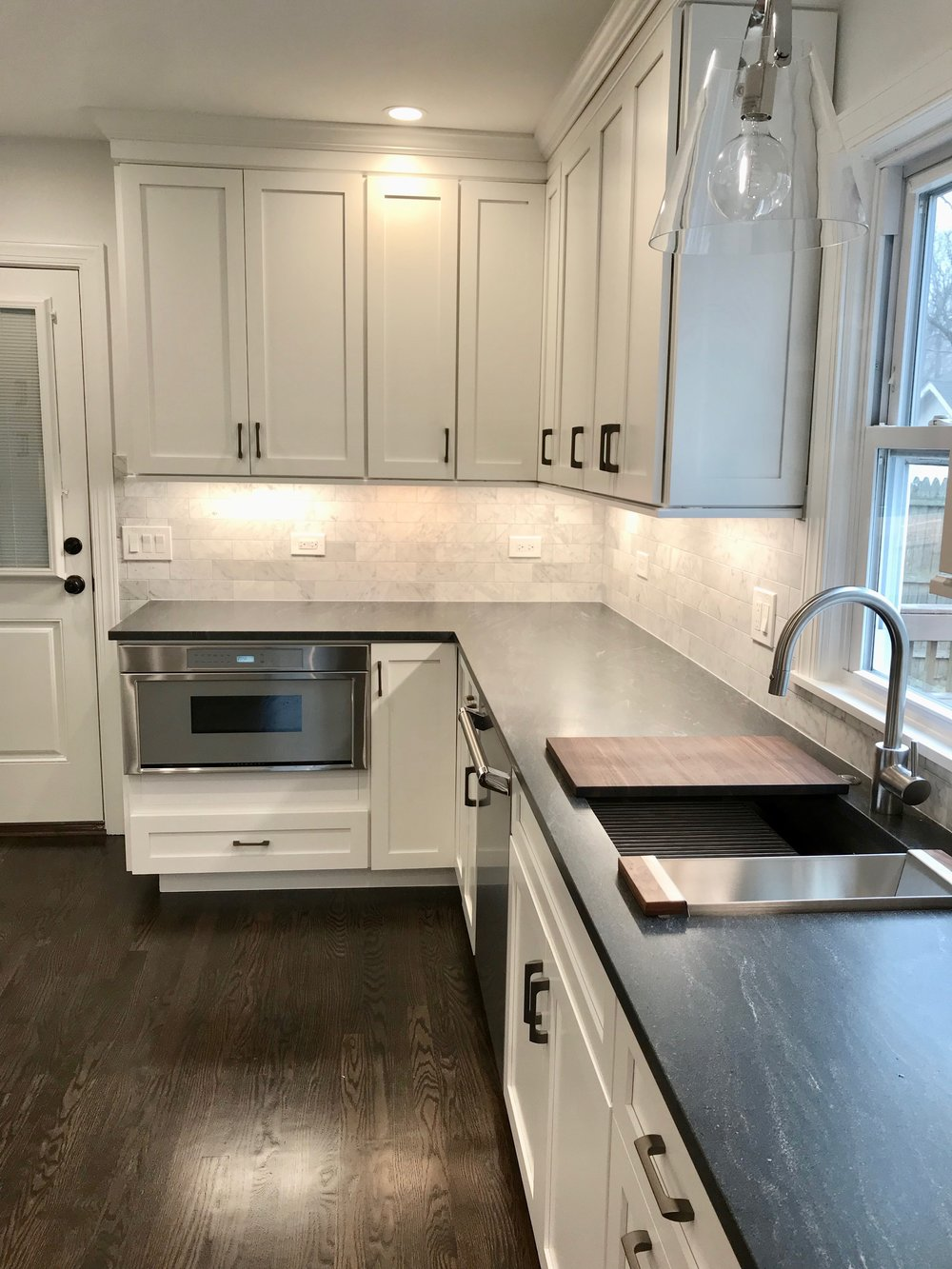 The new kitchen features Thermador appliances , a multi-function sink, and honed granite countertops.