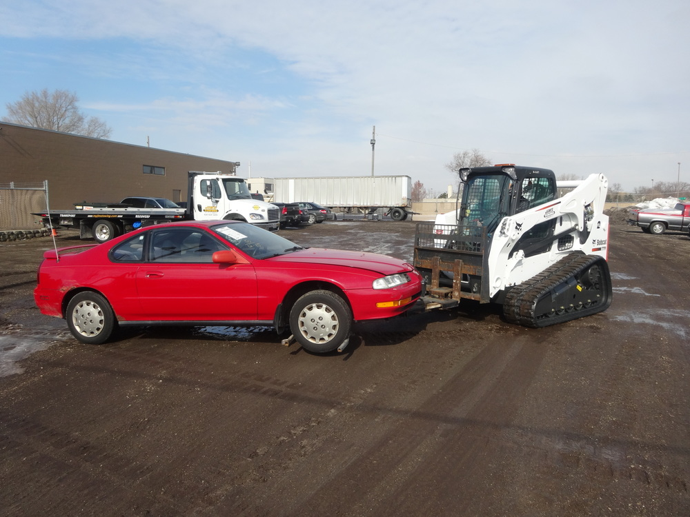 Storage Impound Lot - The wheel lift attachment seen here eliminates any damage while the vehicles are processed into impound.