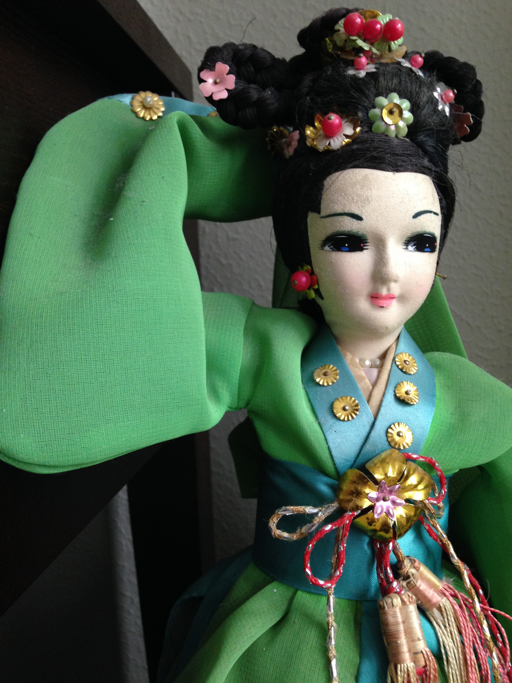This is a doll my grandma picked up during her global travels that I was lucky to inherit. Her vibrant colors are so gorgeous. She hangs out in my office these days.