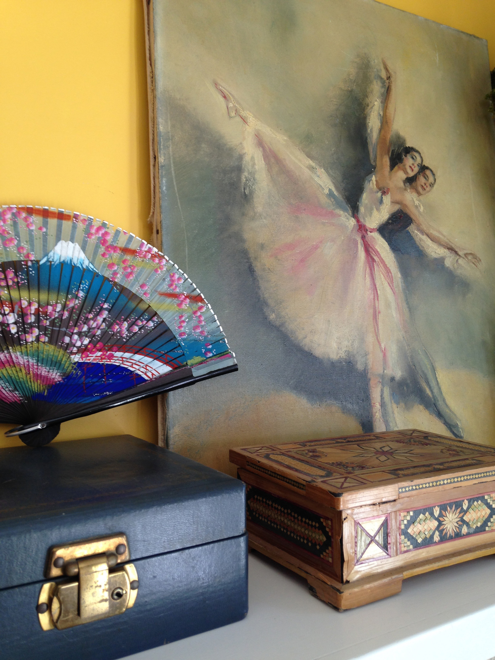 I have several boxes like these beauties full of costume jewelry, gloves and hair accessories that belonged to my grandmother and mom. The painting of the dancers is from Grace's trip to France and the hand painted fan from her adventures in Asia.