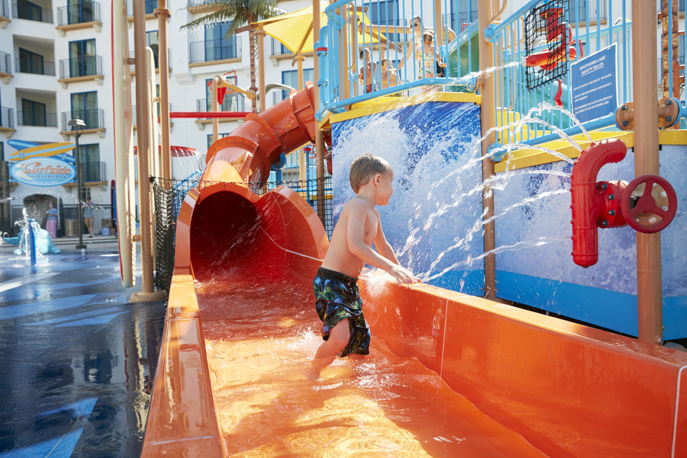 'Hang Ten' Slide  - Put your toes on the nose and get ready to catch a wave! This slide finishes under the 400 gallon dump bucket so watch out for the wipe out!