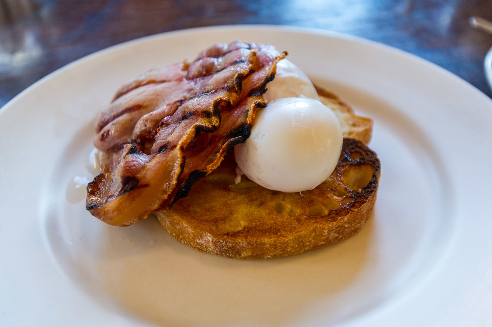 Poached eggs and streaky bacon served on toast at Floriditas in Wellington.