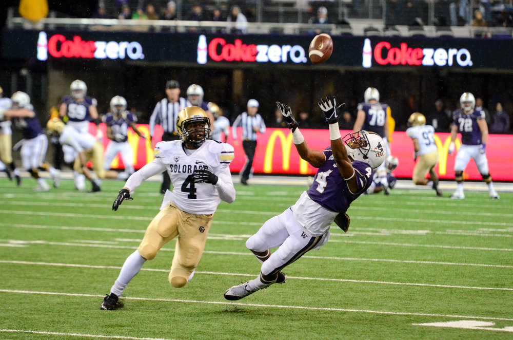 University of Washington Huskies Wide Receiver Jaydon Mickens Reception During Football Game against Colorado University Buffalos