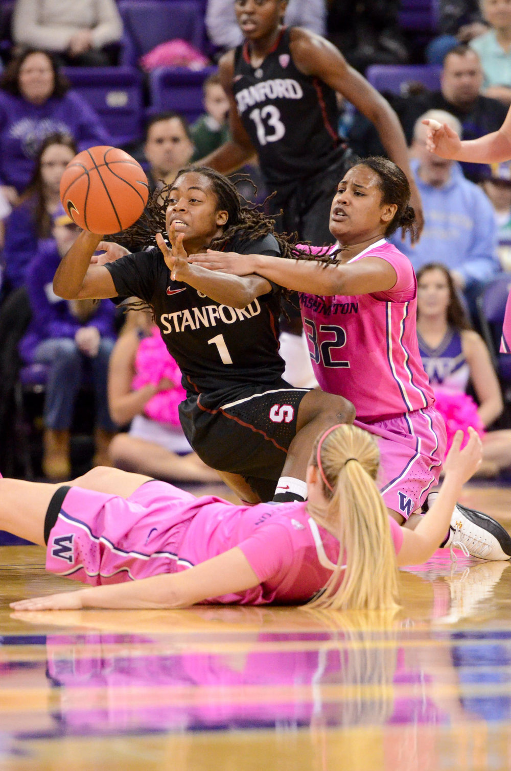 University of Washington Huskies Women's Basketball Point Guard Jazmine Davis Fighting for Ball