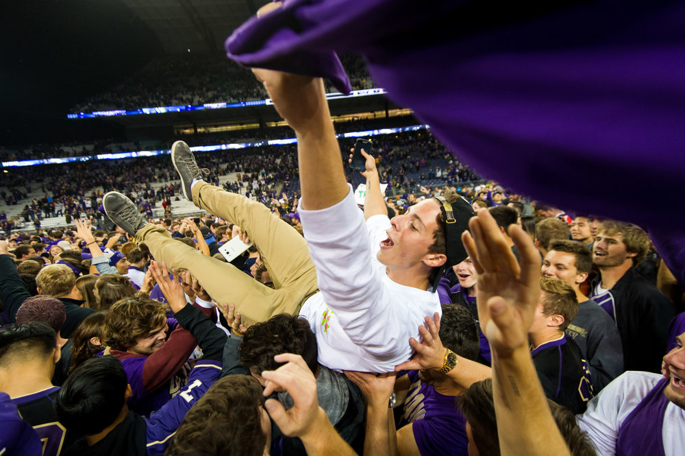 Student Fan Celebrates after University of Washington Huskies Football Upsets Stanford Cardinals