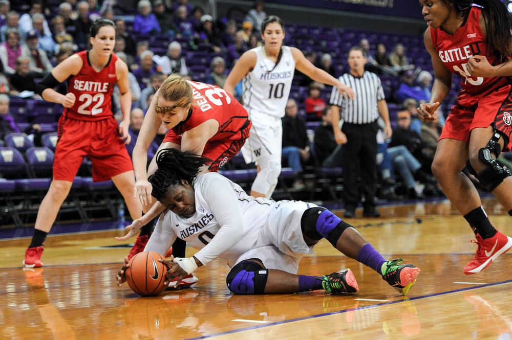 University of Washington Huskies Women's Basketball Chantel Osahor Dives for Ball against Seattle U Redhawks