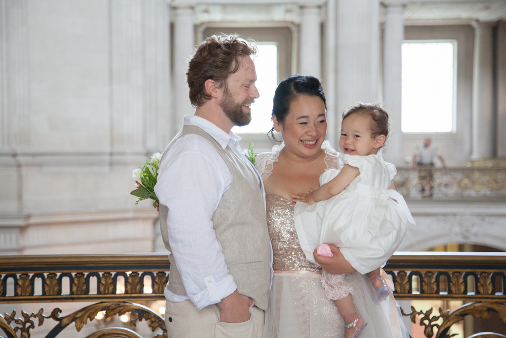 """Thank you Meo! what a wonderful photographer to work with. She was professional and yet personable and has very reasonable rates. We were very pleased with our photographs at SF City Hall"" -Grade, Adam and Baby Olive, San Francisco City Hall"