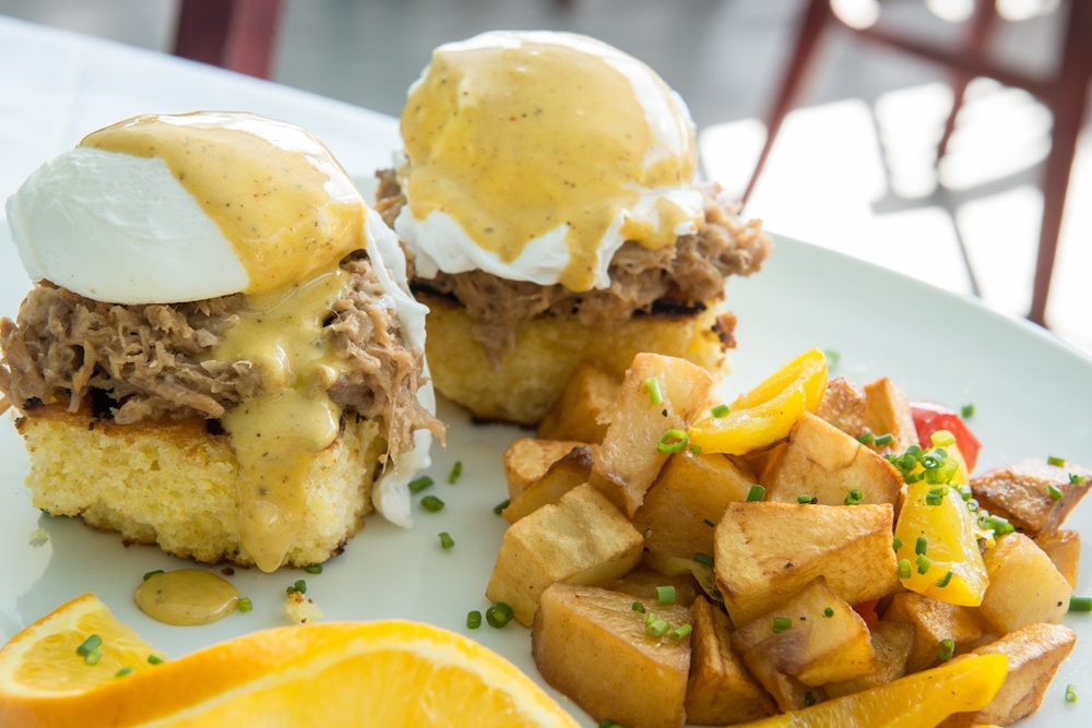 Bagatelle brunch, southern Benedict with pulled pork and house potatoes
