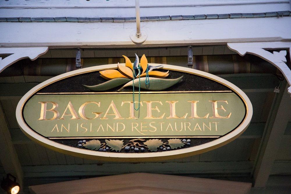 Exterior hanging sign outside Bagatelle restaurant