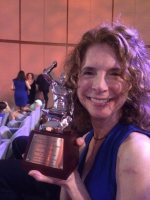Kelliann Amico with her Silver Anvil awarded for her work on the highly successful 2013 Portland visit of the Dalai Lama.