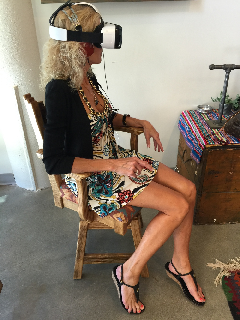 Carole Conkling experiencing TOMS new virtual reality experience at the company's Portland store.