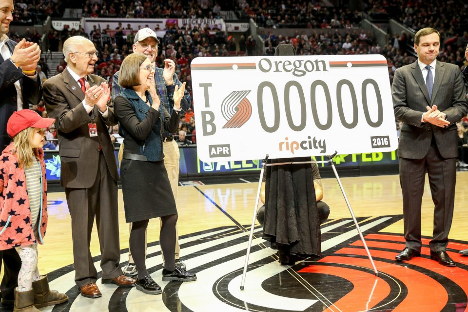 Oregon politicians, including Gov. Kate Brown, unveil the new Portland Trail Blazers license plate during a first quarter timeout against Atlanta Hawks at the Moda Center in Portland, Oregon, January 20, 2016. (Thomas Boyd/The Oregonian)