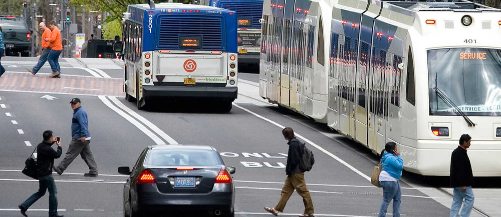 The growing presence of light rail, buses, cars and pedestrians across Portland adds to the congestion on surface roads.