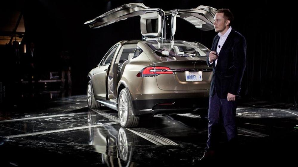Elon Musk, the creator of Tesla and SpaceX, is an indisputable visionary for his innovations, like the Model X electric crossover, shown here in its 2012 unveiling. But Musk is an effective speaker because he brings the future to the present, breaks big topics into small ones and loves to talk about doors.  (Photo Credit – Paul Sancya, The AP)