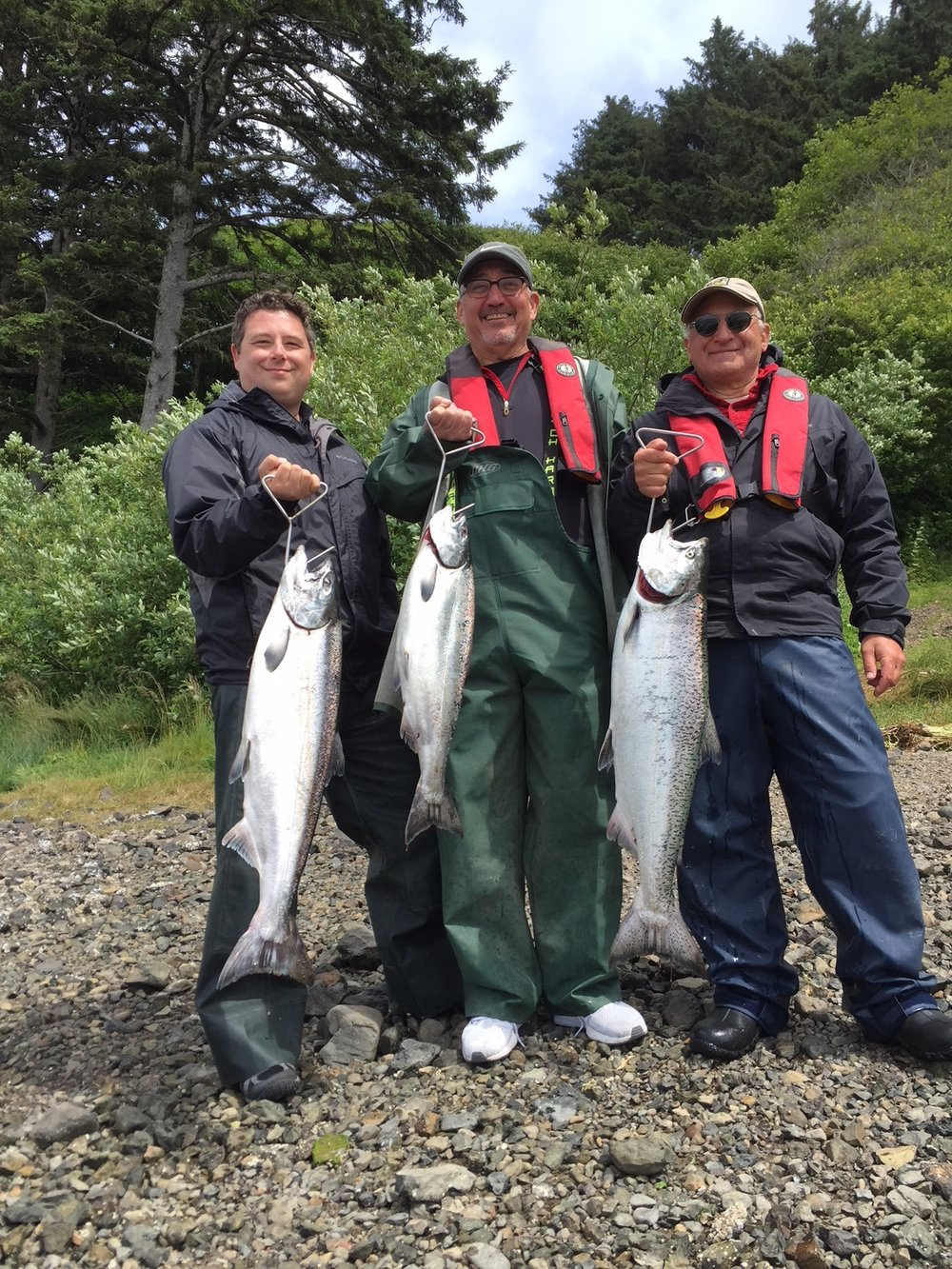 Dale Penn II, along with Tom Eiland and Norm Eder, showing off their prize catches