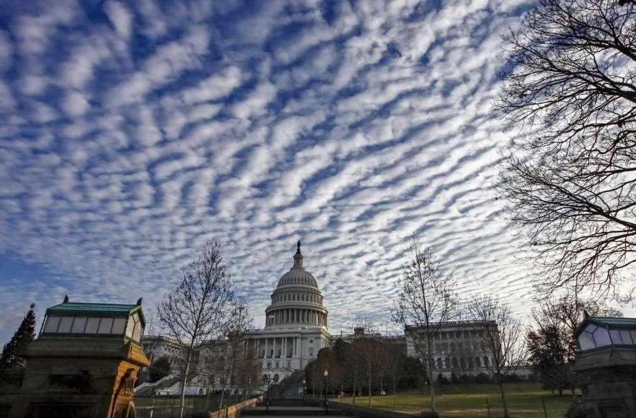 Turbulent clouds hovering over the US Capitol are apropos for the bevy of big issues and decisions that are pending, and for the prospects of more unexpected shoes to drop.   Photo Credit: J. Scott Applewhite, AP