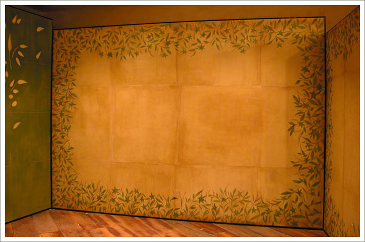 Vignette Walls: Left wall: Hand painted floral design on burlap.  Right wall: Venetian Plaster. Anthropologie store. St Louis, Missouri.