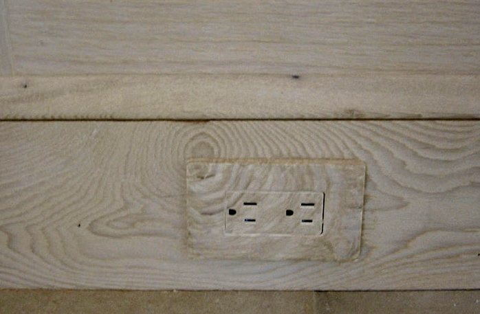 Faux wood outlet to blend existing wood on baseboard.