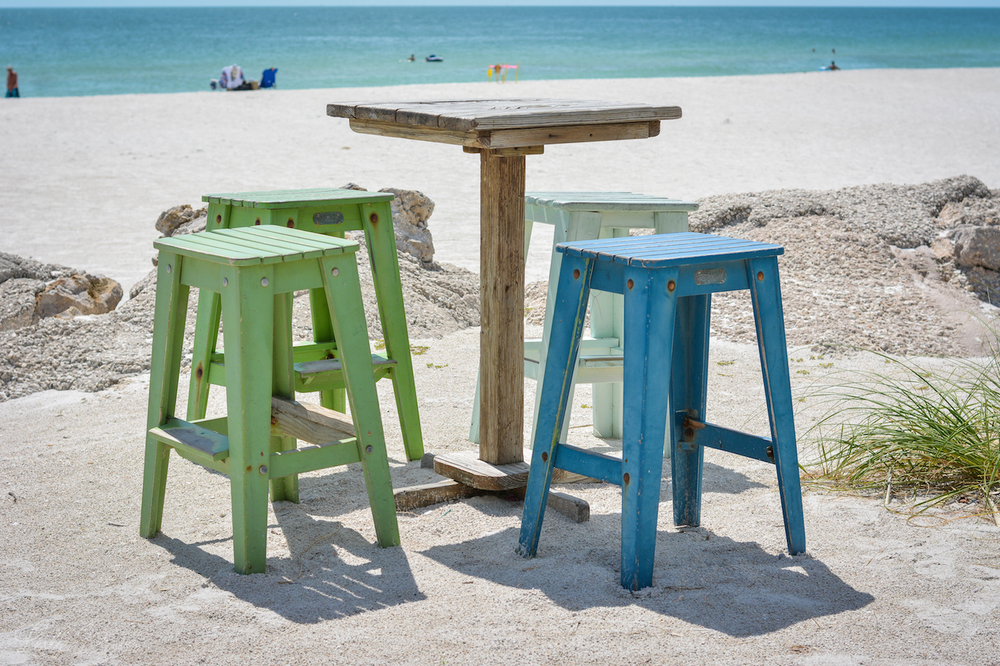 Empty Chairs on Beach - Leslie Brown