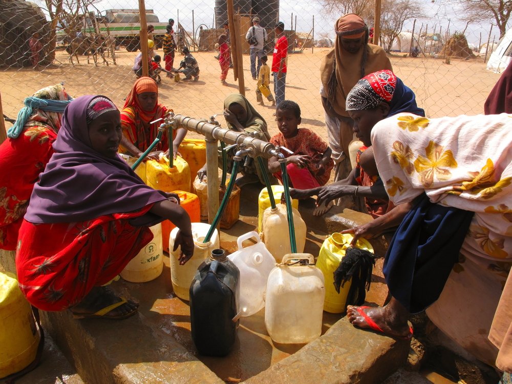 women at water well