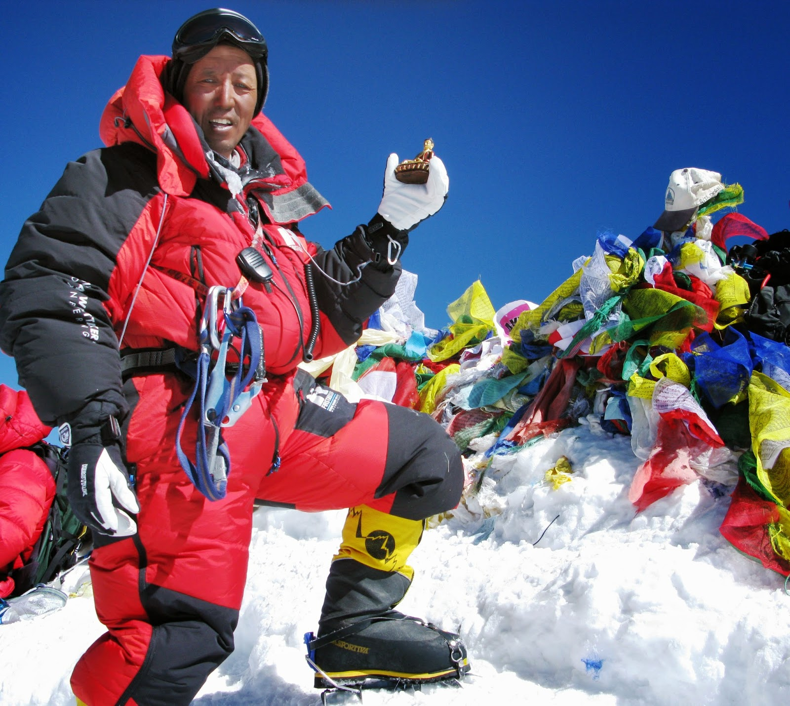 Apa Sherpa on the summit of Everest with a memorial to Sir Edmund Hillary who passed away in 2008. Photo credit: Apa Sherpa Foundation