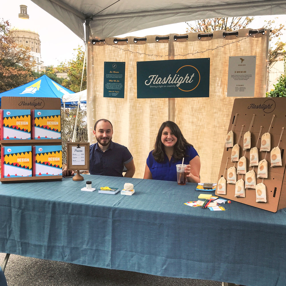 Design Apprentices Aaron and Tania holding down the Flashlight booth at the Atlanta Maker Faire