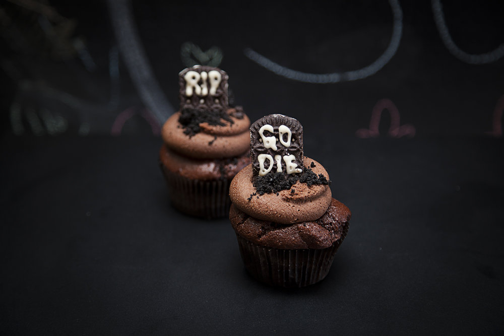 TOMBSTONE - $4 - Confront your friends with their mortality... then drown your fears together in our classic chocolate cupcake. Topped with gf/v 'Oreo' grave marker