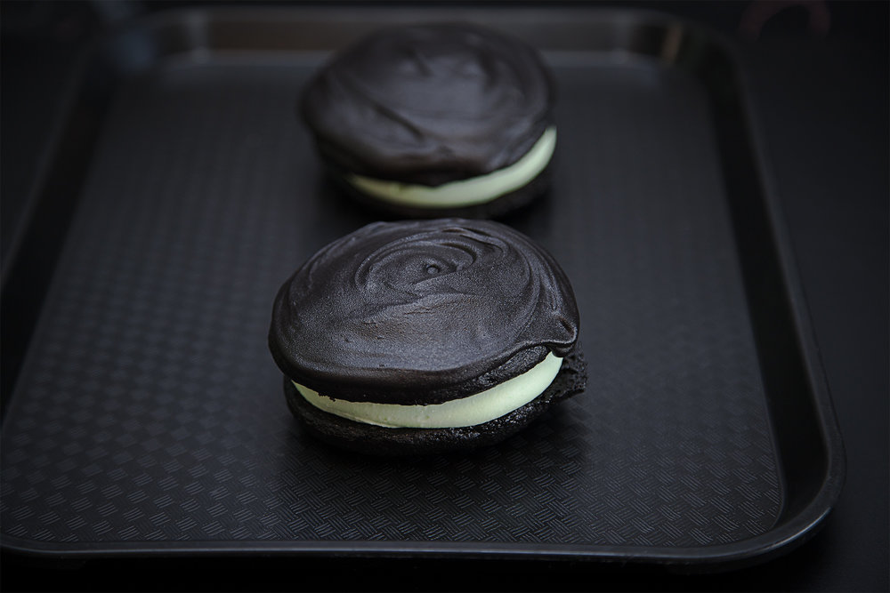 JOSE-MEAN - $5 - The evil twin to our famous Josephine Louise - Black chocolate cake sandwiching a thick layer of pale green cool mint  cream frosting